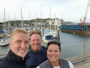 Woods family in front of of bay at yacht club in Dover, England
